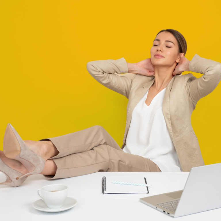 woman relaxing with feet up on desk